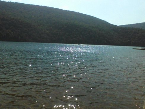 lake sparkling in the sun by mountains in PA