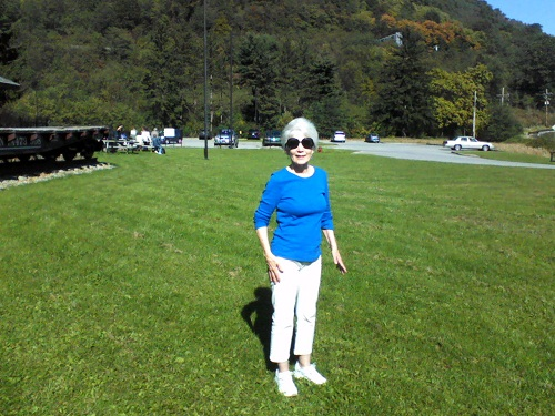 at the Horseshoe Curve in Altoona PA on the grass with mountains behind