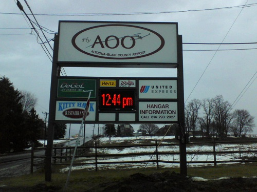 sign at the entrance of the Altoona Blair County Airport in Martinsburg PA with the id AOO