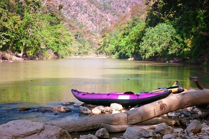 purple kayak at lake