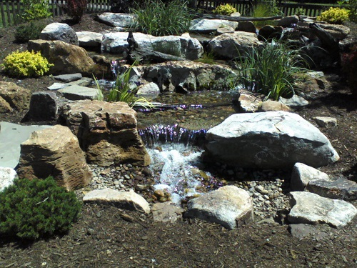 water cascading over rocks in Hollidaysburg garden