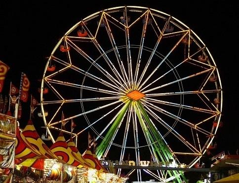ferris wheel lit up at night at a fair