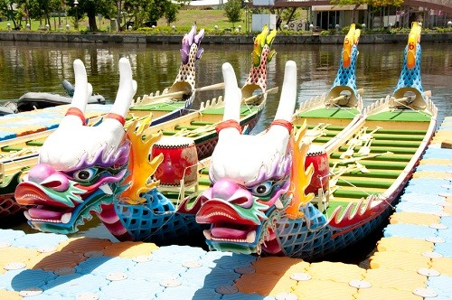 two dragon boats on the water