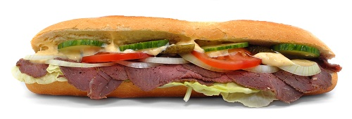 homemade submarine hoagie sandwich with roast beef, cucumbers, onions, tomatos, and melted cheese