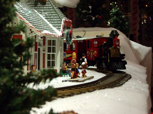 miniature train display with red train and figurines