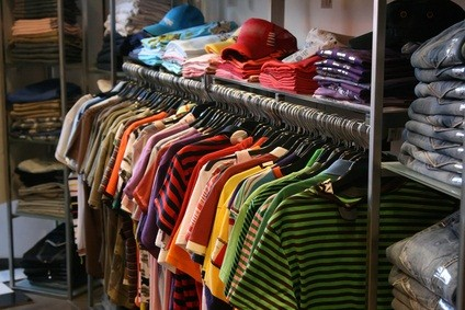 racks full of colorful short sleeved shirts in a PA outlet