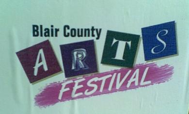 aqua, purple, blue, maroon and green sign for the Blair County Arts Festival in Altoona PA