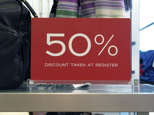 pa malls maroon 50% off sale sign in mall store window