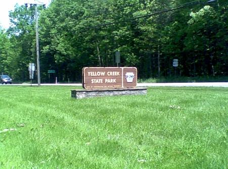 brown Yellow Creek State Park sign on green grass with green trees in the background in Penn Run PA Indiana County PA