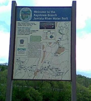 Pennsylvania rivers Juniata River Water Trail sign in Bedford PA with green mountains in the background