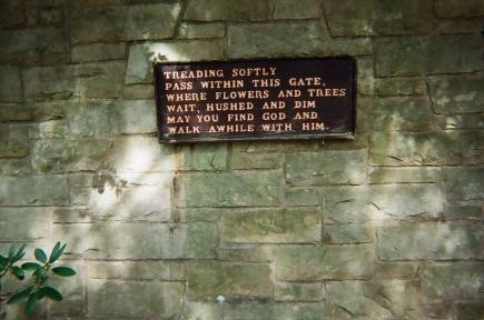 sunken gardens at the Schwab Estate in Loretto PA sign hanging on the stone wall