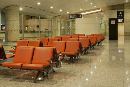 PA airport waiting area with rust colored seats