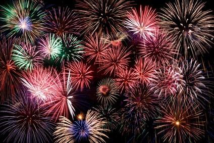 green, blue, pink, gray, white fireworks display