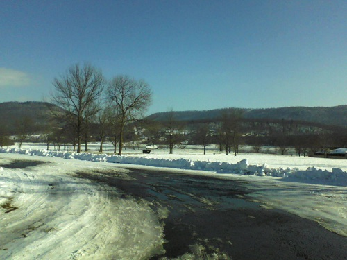 Pennsylvania Canoe Creek State Park in January with snow on the ground and a mountain backdrop with blue sky