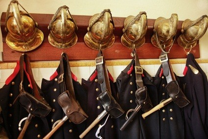 old preserved firemen's blue uniforms and gold hats in a Philadelphia museum in PA