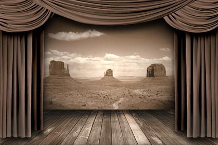 grayish tan curtain on a stage with a wooden board floor
