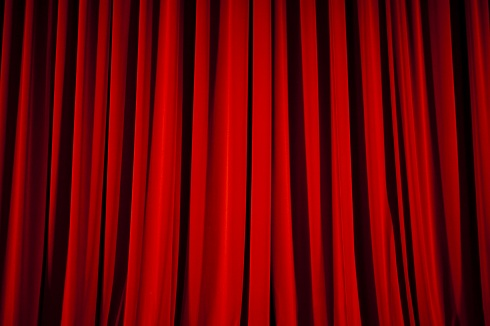 red center stage curtain at the theater