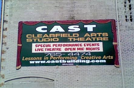 theatres in Pennsylvania green, white and maroon Clearfield Arts Studio Theatre sign on a gray brick and stone building in Clearfield County PA