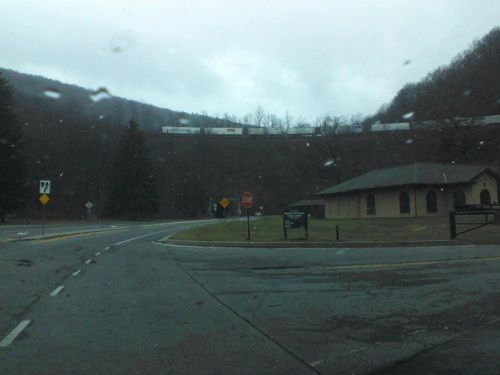 a train rounds the curve at the Horseshoe Curve on a rainy day