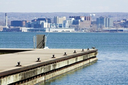 Erie Pennsylvania lake and city view with a pier. blue water, and buildings