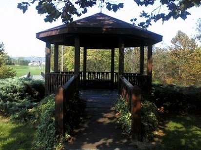 autumn in Pennsylvania round gazebo with an entrance walkway surrounded by trees