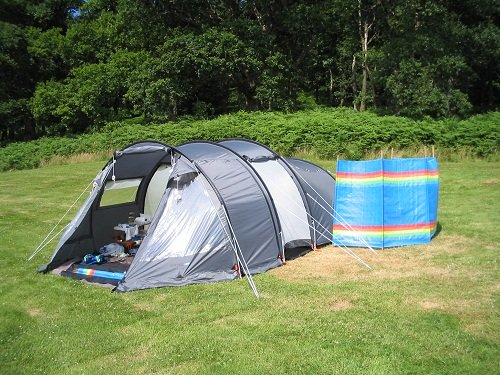 one gray tent on the grass