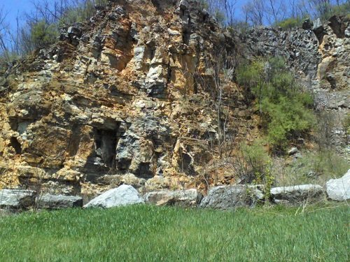 limestone rock formations at Chimney Rocks in Hollidaysburg PA with green grass and blue skies