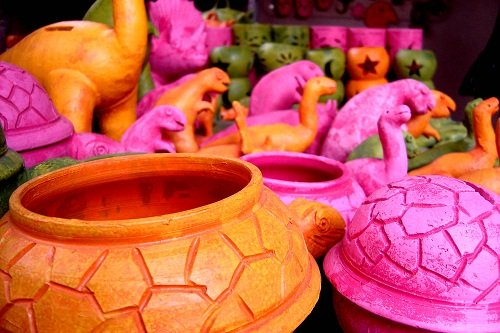 colorful crafts pots, dinosaurs, candle holders at the festival