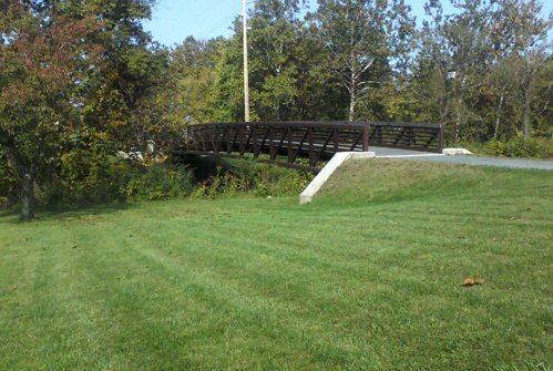 Pennsylvania park with green grass and a footpath bridge