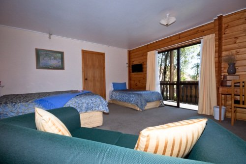 inside the lodge with a coudh, sofa and bed
