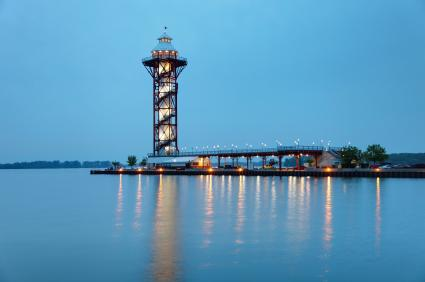 Bicentennial Tower overlooking the blue waters of Lake Erie with blue sky overhead in Presque Isle State Park
