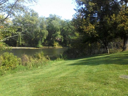 Cumberland County PA lake with green grass and trees
