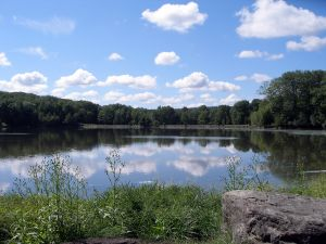 Pennsylvania lakes poconos mountains lake beneath blue sky and white clouds