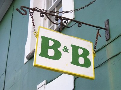 green B&B sign on blue building