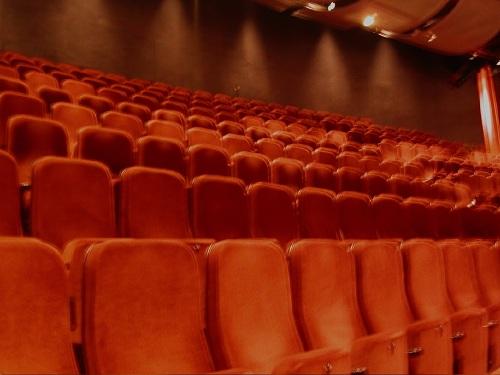 orange seats in a PA theatre