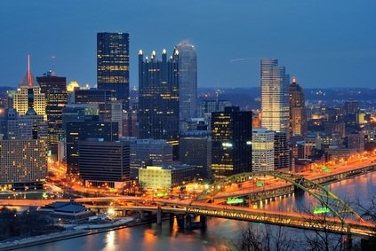 Pittsburgh Pennsylvania at night with lights on in building windows and on bridges