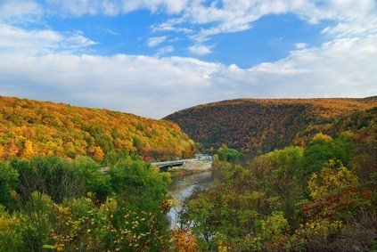 the pocono mountains in the fall with green, orange and yellow trees