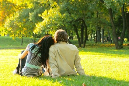 woman and man sitting on the grass on a romantic vacation in PA