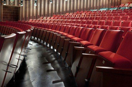 red seats in rows at a theatre